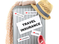 Travel suitcase and tourist stuff with inscription  travel insurance isolated on white